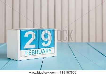 February 29th. Cube calendar for february 29 on wooden surface with empty space For text. Leap year,