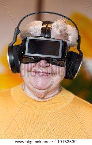 Senior Adult With Vr Glasses