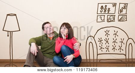 Middle Aged Couple In The New Flat. Embracing Man And Woman At New Empty Apartment.