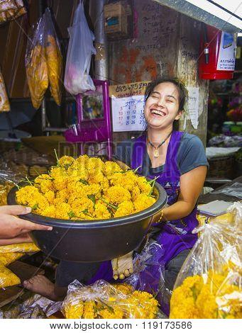 women are selling fresh flowers at the morning market Pak Khlong Thalat