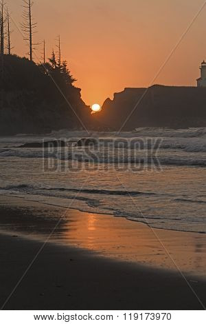 Sunset Between The Rocks On An Ocean Coast