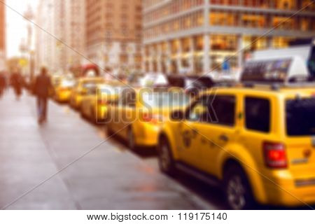 Blurred picture of yellow taxies on Manhattan streets
