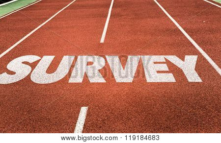 Survey written on running track poster
