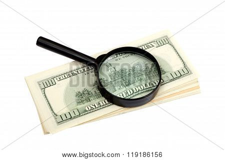 Stack Of Us Dollars Banknotes And Magnifier