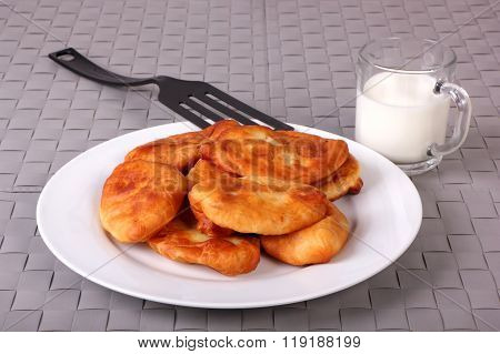 Fried Cakes On White Plate, Plastic Spatula And Cup Of Milk