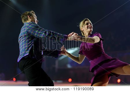 ST. PETERSBURG, RUSSIA - DECEMBER 29, 2015: Figure skaters Albena Denkova and Maxim Staviski in a scene of the New Year show Little Brother and Karlsson-on-the-Roof of Ilya Averbukh