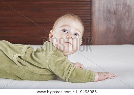 Baby Green Onesie Looking Surprised