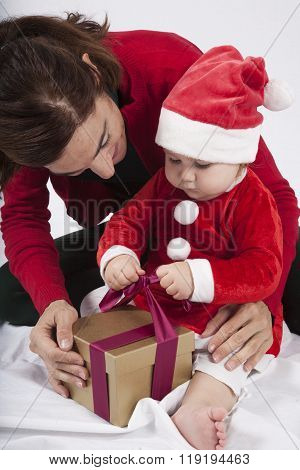 Baby Santa Claus With Mother Opening Golden Gift