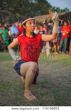 AYUTTHAYA,THAILAND-MARCH 17,2013 : Female Asian wooman shows spiritual dance on Wai Kru Muay Thai Ceremony