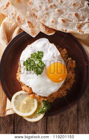 Egyptian Breakfast: Ful Medames With A Fried Egg Close-up. Vertical Top View