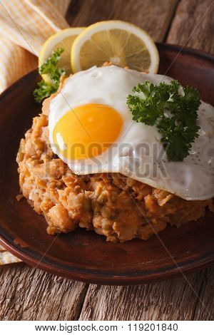 Arabic Cuisine: Ful Medames With A Fried Egg Close-up. Vertical