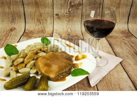 Potato Gnocchi With Roast And Glass Of Red Wine