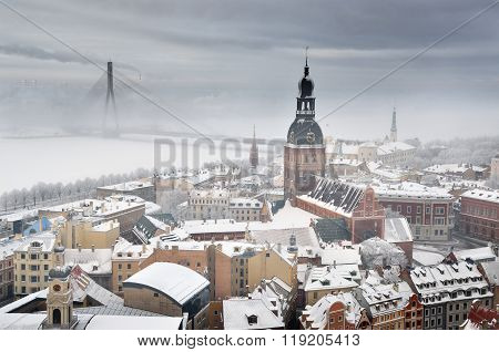 Winter aerial view of Riga historical centre in fog. Landmarks of Latvia. poster