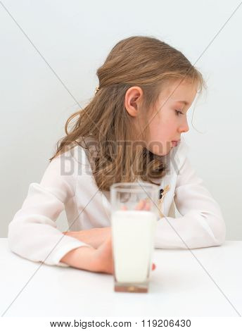 Sad Little Girl With Glass Of Milk.