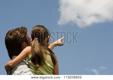 Father and daughter looking at cloud