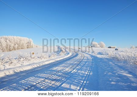 Snowcovered Rural Road In Winter On A Sunny Day
