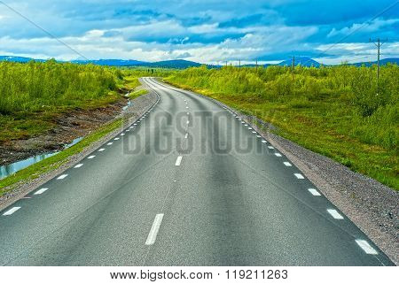 Grey Sweden Road To Norvegian Mountains In Sunny Summer Day