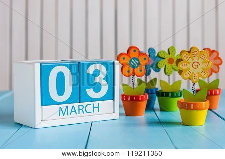March 3rd. Image of march 3 wooden color calendar with flower on white background.  First spring day