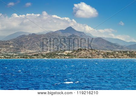 Crete island view with mountains from Lybian sea at Ierapetra beach area, Greece.
