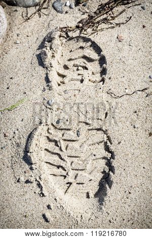 Closeup Of A Shoeprint At The Beach