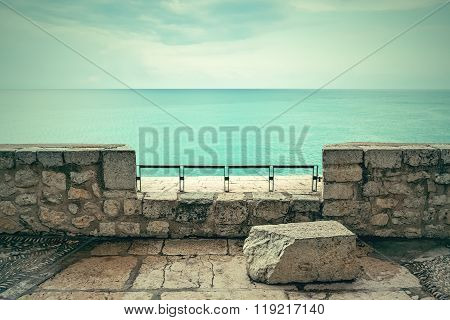 View Over Turquoise Sea And Clouds
