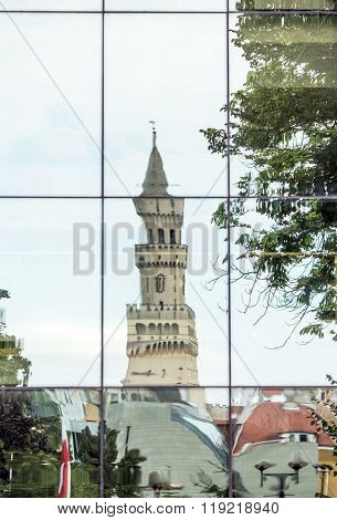 Town Hall Tower reflected in the glass walls of the Opole Philharmonic Building. Opole - Poland
