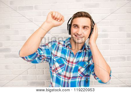 Young Smiling Man Listening To Music In Headphones