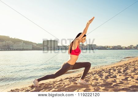 Sexy Young Woman Doing Exercises At The Beach To Be Healthy