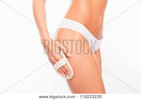 Closeup photo of young woman making spa exfoliation poster