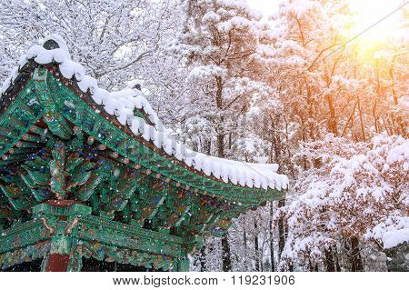 Landscape In Winter With Roof Of Gyeongbokgung And Falling Snow In Seoul,south Korea.