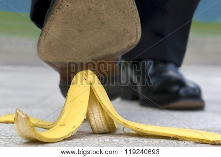 Close Up Businessman Stepping On Banana Skin