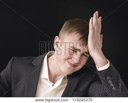 Portrait of an man in a business suit on a black background. Regrets wrong doing