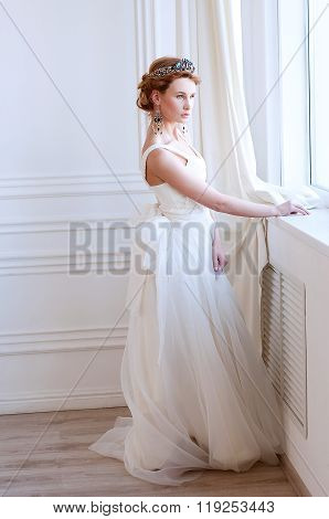 Beautiful royal bride wearing gorgeous  beaded headpiece