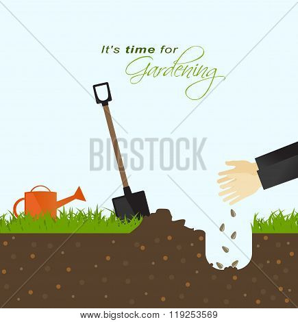 It Is Time For Gardening.person Putting Seeds In The Ground With Spade And Watering Can In Field