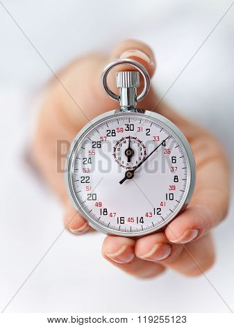 The Clock Is Ticking - Stopwatch In Woman Hand