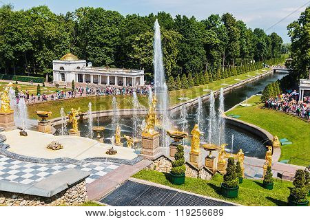 Tourists In Peterhof Fountains Of The Grand Cascade