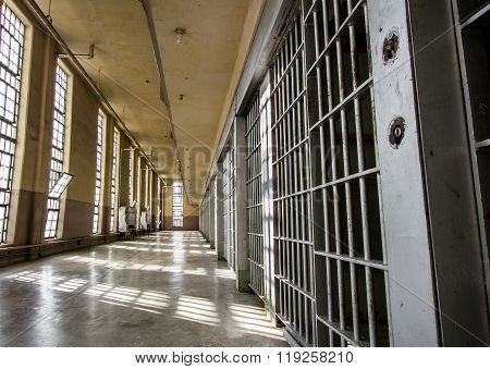 Prison bars and a long lonely hallway