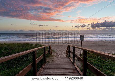 Beautiful ocean beach entrance at sunrise