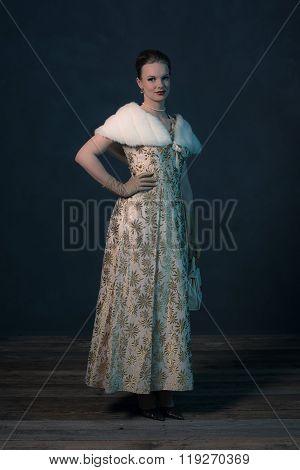 Vintage 50S Glamour Fashion Woman In Gold Dress Holding Handbag.
