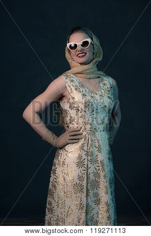 Chique Vintage 50S Fashion Woman Wearing Sunglasses And Scarf Around Head.