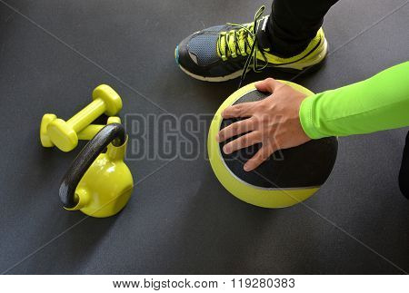 Man Training With Kettlebell And Medicine Ball