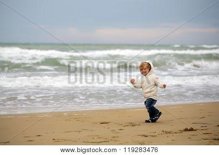 Joyful Boy Running At Beach