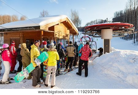 People Stand In Line On chairlift In