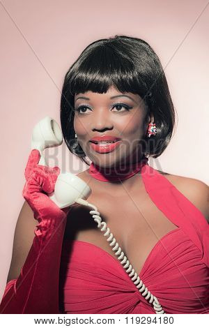 Retro 60S Fashion African Woman In Red Dress Holding Earpiece Of Telephone.