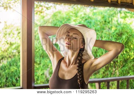 Young Lady On A Sunny Balcony