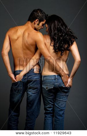 Sexy romantic young couple in jeans