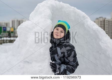 Teen Boy Standing In  Makeshift Snow Fort