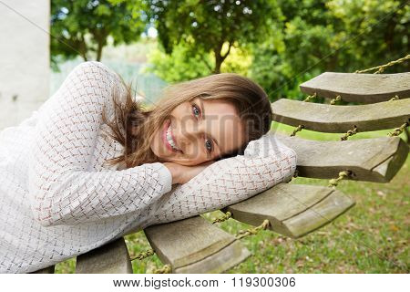 Smiling Attractive Woman Relaxing On Hammock Outside