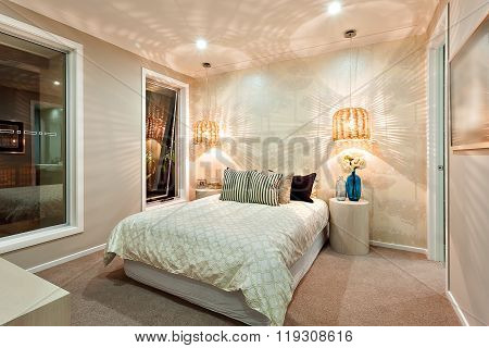 Light Pattern Drawn On The Wall Using Bamboo Lamps In The Luxury Bedroom