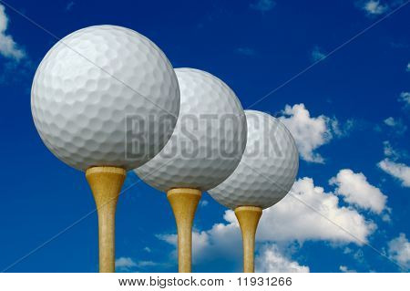 Three Golf Balls & Tees on the left with clouds and sky background.
